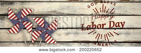 Digital composite image of happy labor day and god bless America text against wood panelling