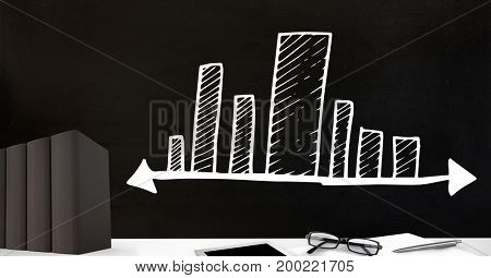 Digital composite of Desk foreground with blackboard graphics of bar charts incremental stretching
