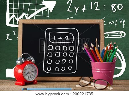 Digital composite of Desk foreground with blackboard graphics of calculator and formula