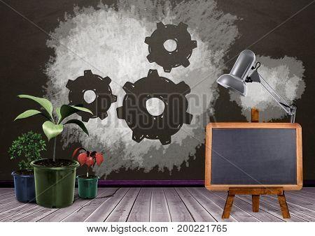 Digital composite of Blackboard and plants with setting cog gears on blackboard