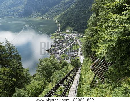 High-altitude cog railway, rail lift in Hallstatt. Mountain lake, Alpine massif, beautiful canyon in Austria. Salzburg Alpine valley in summer, clear water. Destination for vacation, bird perspective.