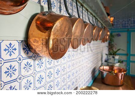 Giverny, France - 20 Oct 2016: inside the home of French impressionist painter Claude Monet, the kitchen with copper pots