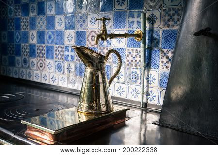 Giverny, France - 20 Oct 2016: inside the home of French impressionist painter Claude Monet, the kitchen is equipped with a metal jug on old furnace