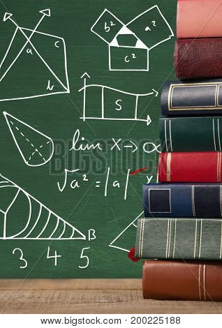 Digital composite of Books on Desk with blackboard graphics of math diagrams