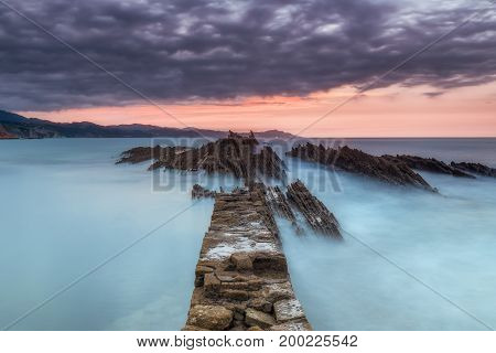 Sunset at Itzurun beach in Zumaia in Spain