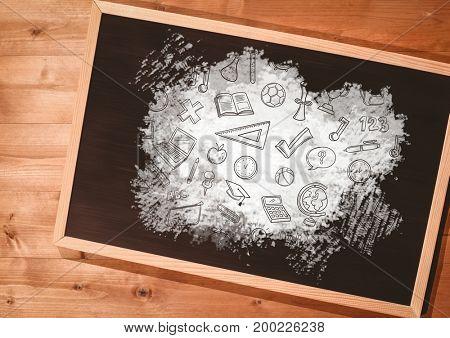 Digital composite of education graphics on blackboard