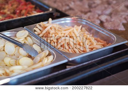 French Fries and Potato Chips on a Fast Food Stand