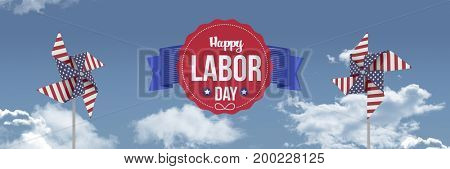 Digital composite of Happy labor day text and USA wind catchers in front of sky