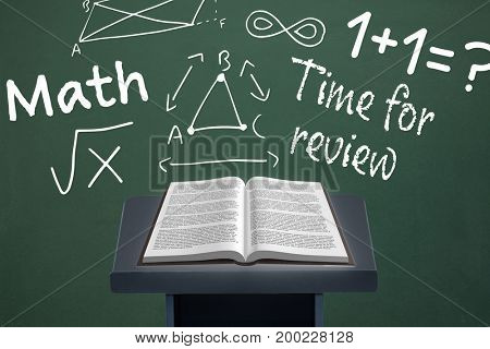 Digital composite of Book on speech table against green blackboard with education and school graphics