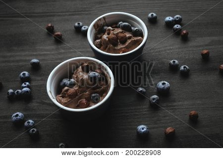 Chocolate Ice Cream With Blueberries And Hazelnuts