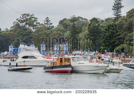 SYDNEY,NSW,AUSTRALIA-NOVEMBER 19,2016: Group of yachts and nautical vessels in farm cove for The Plot 2016 music festival at Parramatta Park in Sydney, Australia.