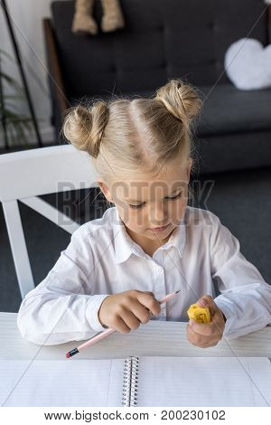 Child Sharpening Pencil