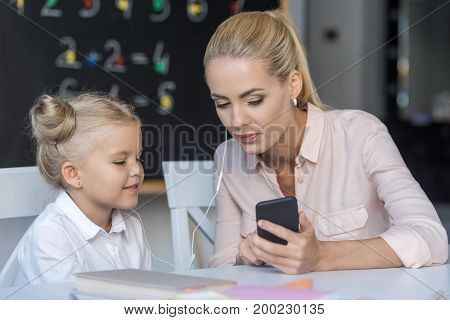 Mother And Daughter Using Smartphone
