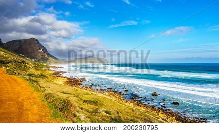 The Atlantic coast along the road to Chapman's Peak at the Slangkop Lighthouse near the village of Het Kommetjie in the Cape Peninsula of South Africa