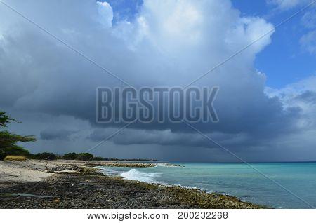 Dark swirling clouds over the coastline in Aruba.