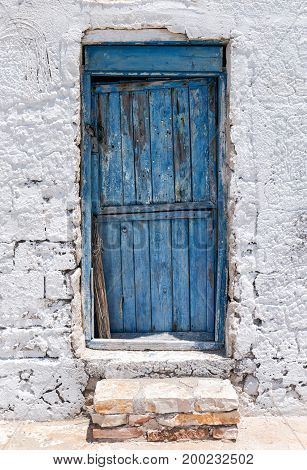 Traditional blue door on a cyclades island in Greece