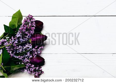 Bunch Of Lilac Flowers With Tulips On White