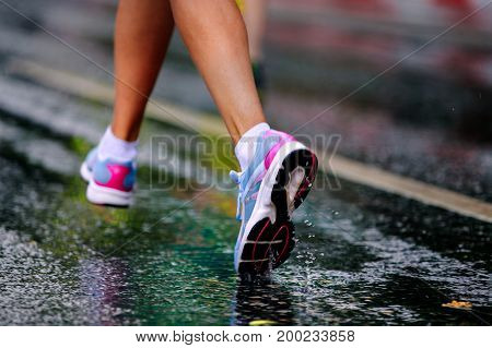closeup of water drop in running shoe girl runner