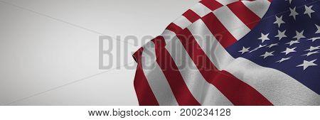 Digital composite of 3D USA flag against grey background