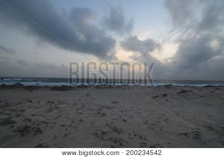 Dark clouds in the skies over a sand beach in Aruba.