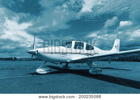 PRIBRAM Czech republic - July 12 2017. Private single turboprop aircraft CIRRUS SR22 parked on runway in sunny day. Travel concept. Sport concept. Ready for fly. Technical blue colored.