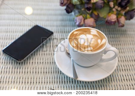 Beautiful Frangipani Plumeria Flower Art Latte Of Hot Coffee Drink Tasty In Cafe Restaurant With Mob
