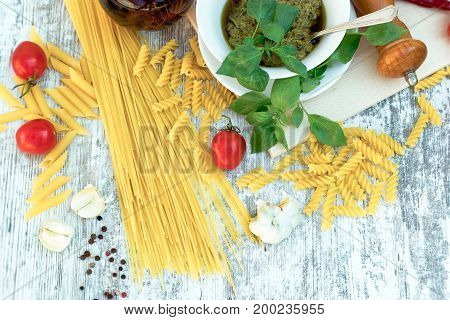 Homemade basil pesto sauce on rustic wooden table -healthy Mediterranean food