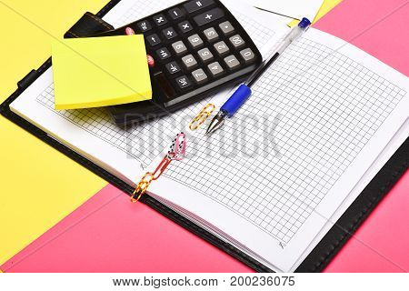 Business And Work Concept: Calculator And Notebook