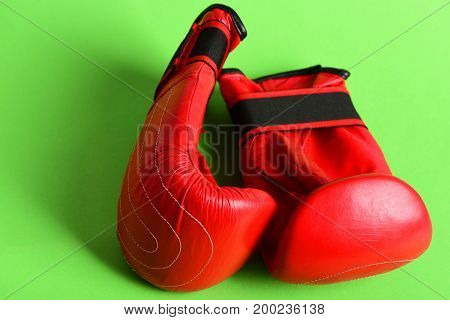 Boxing Gloves Isolated On Green. Concept Of Sport