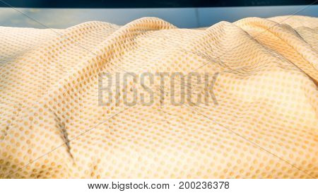 Close up of Yellow Chamois (microfiber towel) on car - Cleaning Concept