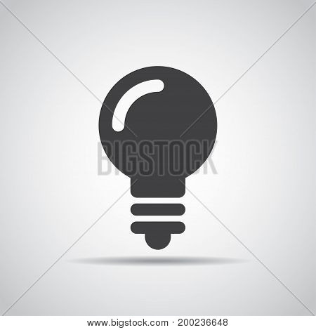 Lightbulb icon with shadow on a gray background. Vector illustration