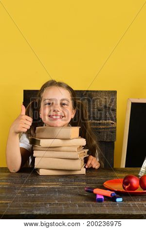 Kid And School Supplies On Yellow Wall Background