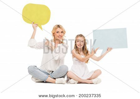 mother and preteen daughter pointing at colorful blank cards isolated on white