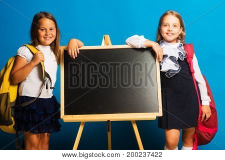 Girls In School Uniform On Blue Background