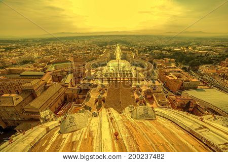 Aerial view at dusk time from the cupola of Papal Basilica over St. Peter's Square in the Vatican City. Rome Italy.