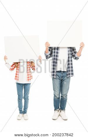 obscured view of father and daughter with blank banners isolated on white