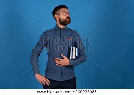 Teacher With Glasses And Notebooks. Man With Beard And Books