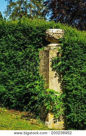 Beautiful Park In Antique Style, Stone Decorations On Pedestals, Beautiful Plants