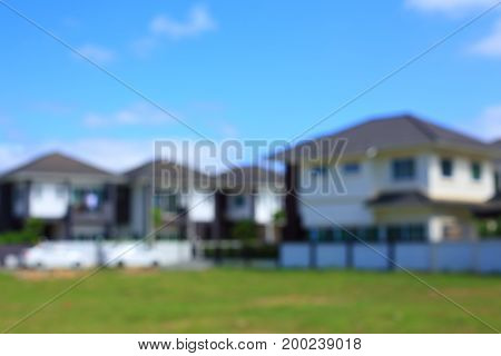 residential house village suburb with grass field playground image blur background