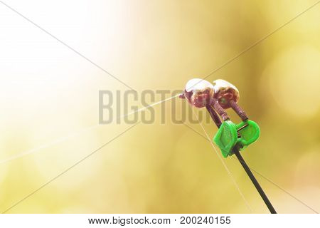 The Bell On The Fishing Rod. Spinning Equipment. Sunlight