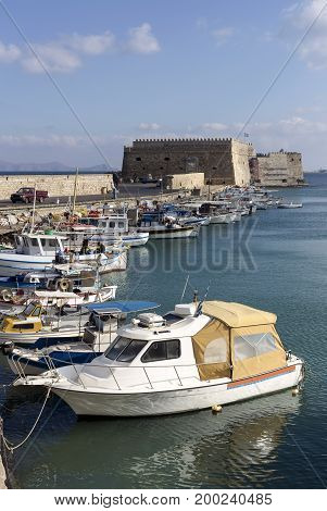 View of the quay, the Venetian fortress and the moored boats and yachts  (city Heraklion, island Crete, Greece).