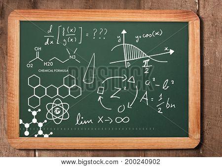 Digital composite of chemical science formula on blackboard