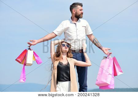 Sexy Girl Sits By Guy With Serene Face And Purchases