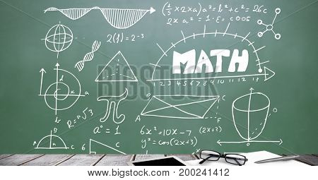 Digital composite of Desk foreground with blackboard graphics of math diagrams
