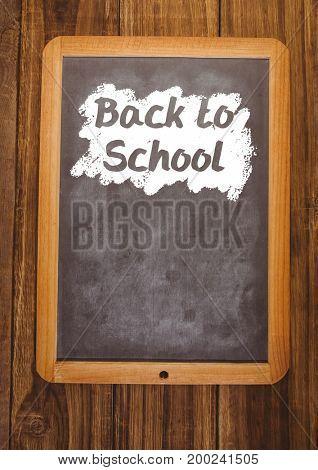 Digital composite of back to school text on blackboard