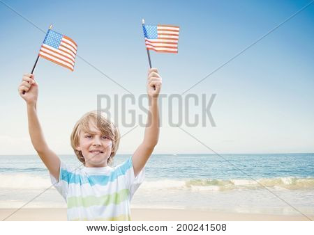 Digital composite of Happy boy holding USA flags in the beach