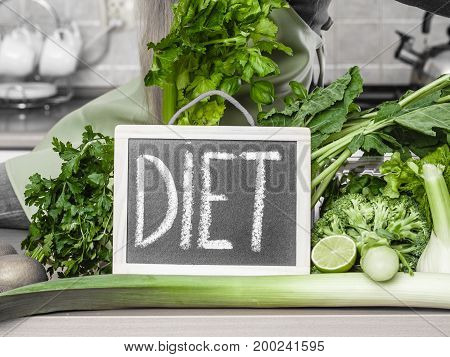 Kitchen Table With Many Green Diet Vegetables