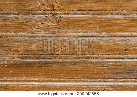 texture of old boards with remnants of brown paint