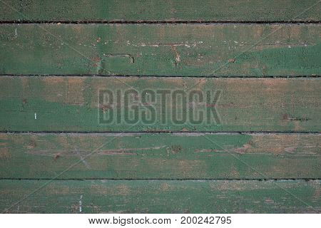 texture of old boards with remnants of green paint