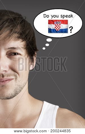 Handsome student thinking do you speak Croatian?